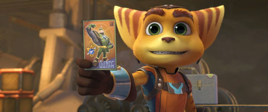 Ratchet_holds_up_his_QWARK_TRADING_CARD-Highres_copy.png